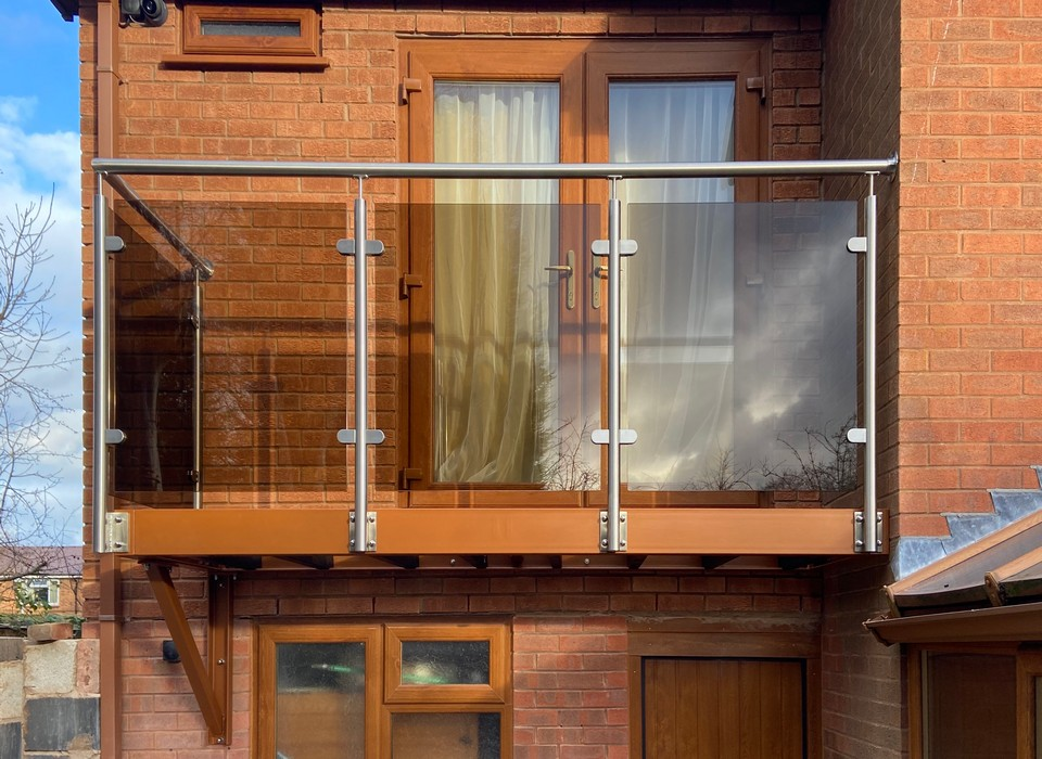 Balcony with glass and stainless steel balustrade and bronze tinted glass