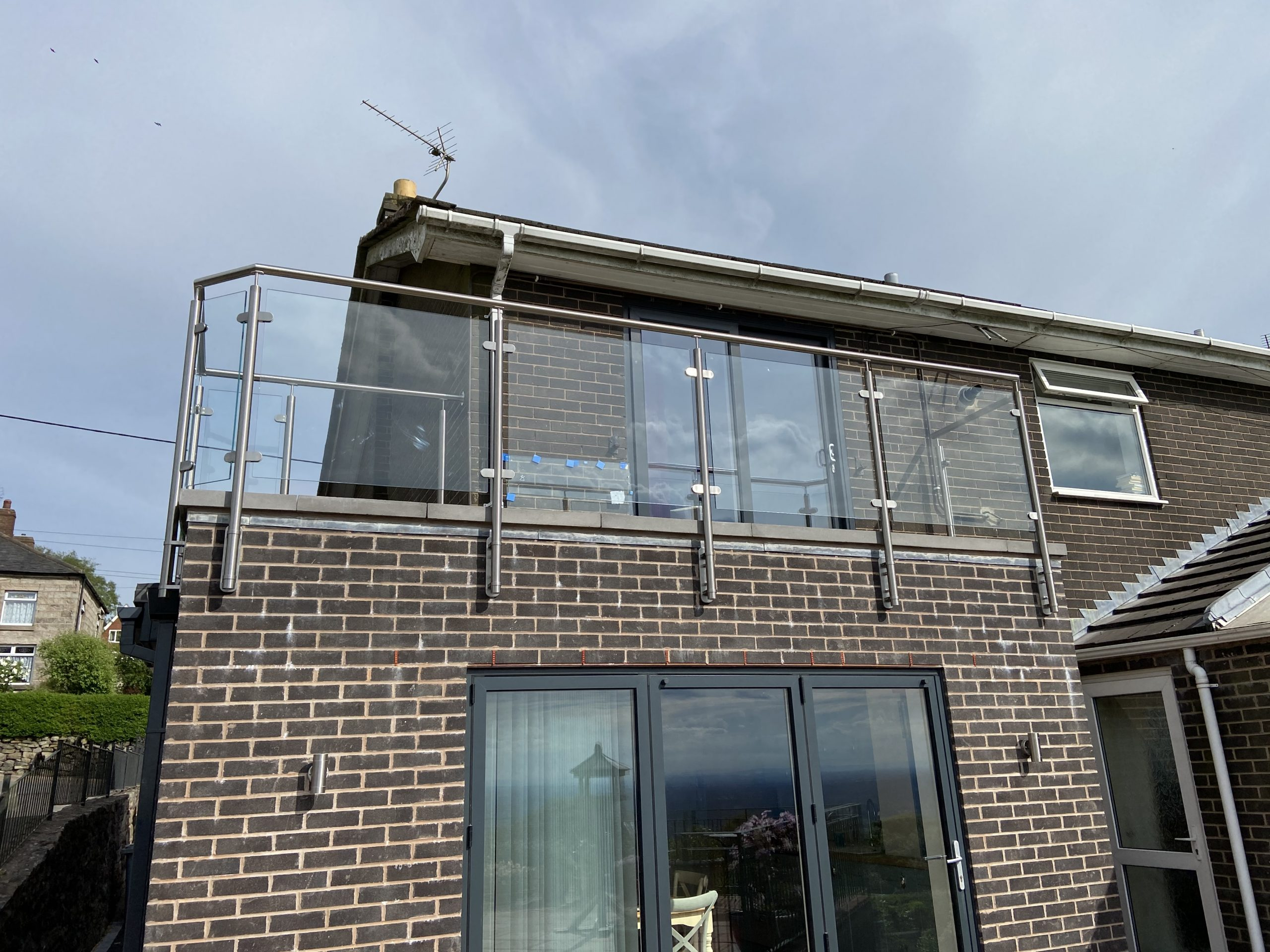Stainless steel and glass balustrade on roof terrace